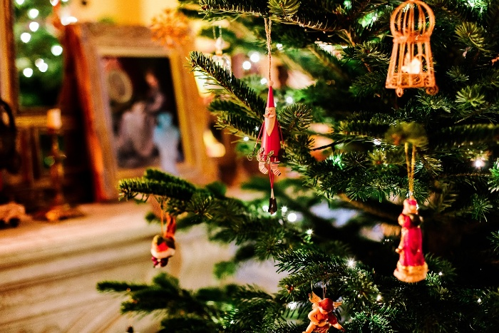 christmas traditions decorated tree indoors with hanging ornaments