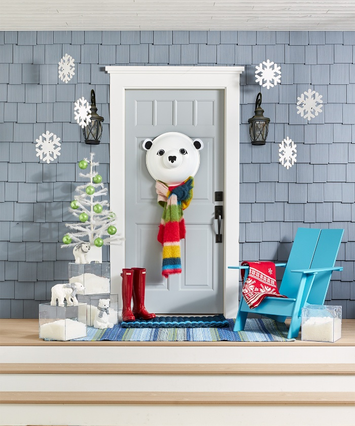 light blue door decorated with a bear red boots snowflakes