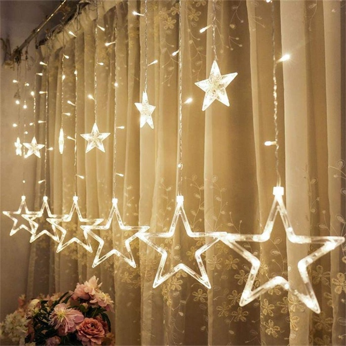 fairy star lights handing on the curtains two sets of stars