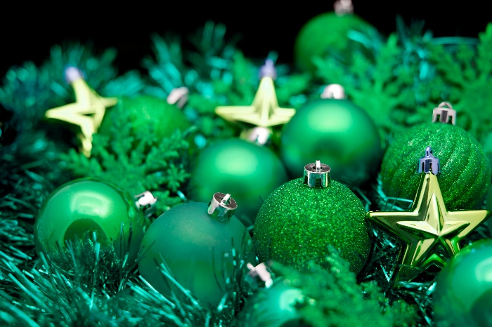 green christmas decorations starts baubles and garlands in different shaded of green