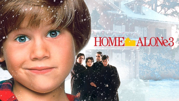 best christmas movies home alone 3 poster a young boy in front of a snowy home