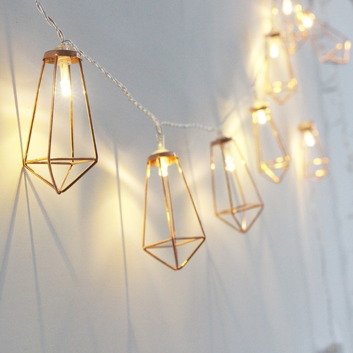 modern fairy lights with metal beams hanging on a clean white wall