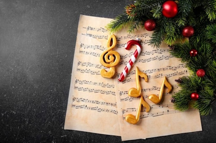 music carols musical notes papers with candy and cookies