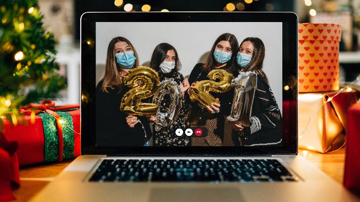 new year's eve party girls with masks on their faces holding balloons on a computer screen