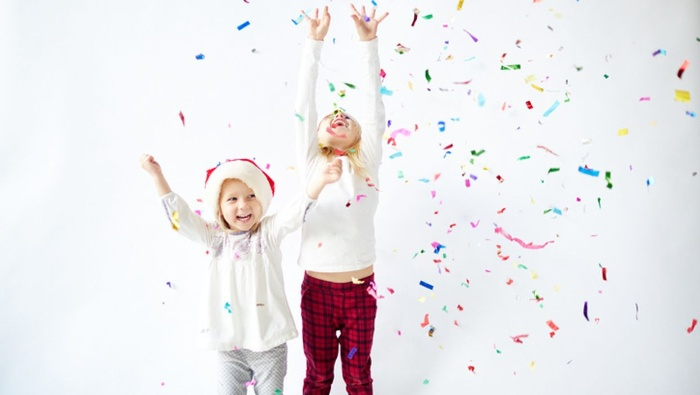 kids on a white background celebrating with colorful confetti