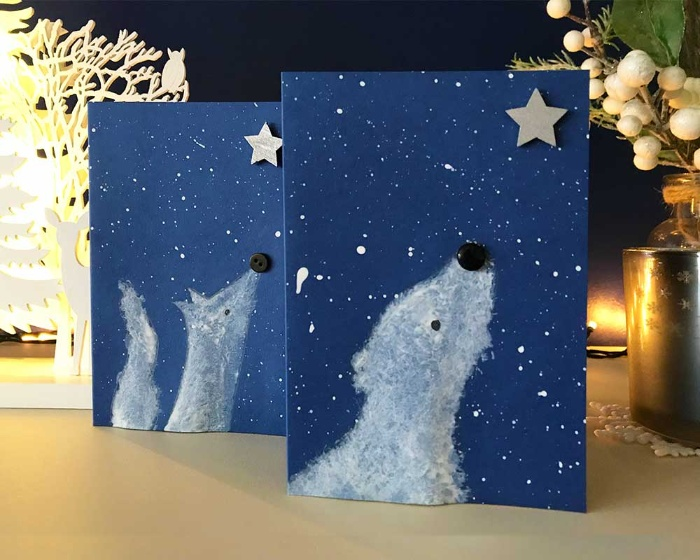 simple christmas cards two blue cards with a wolf and a bear looking at a star