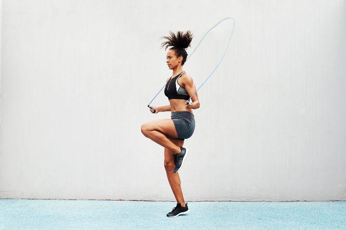 woman in sportswear jumping outdoors