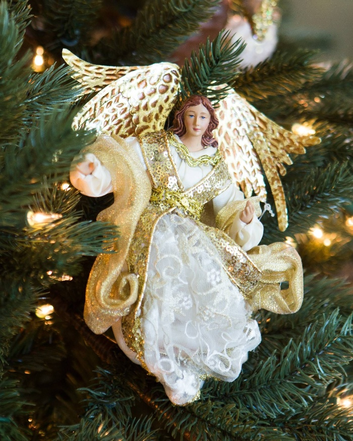 tree ornament angel on a christmas tree dressed in white and gold