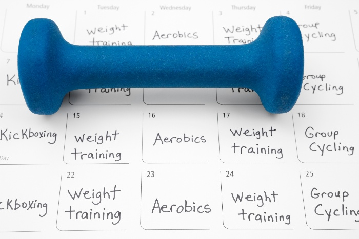 workout schedule stay active during the holidays calendar planning with a blue weigh