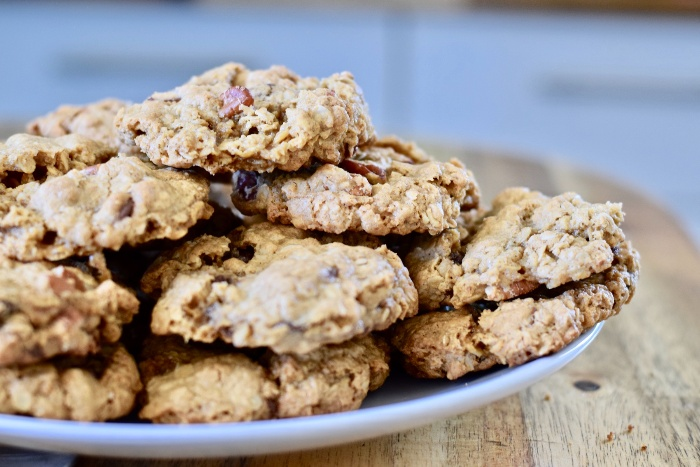 Oatmeal pecan cookies in a plate on a table