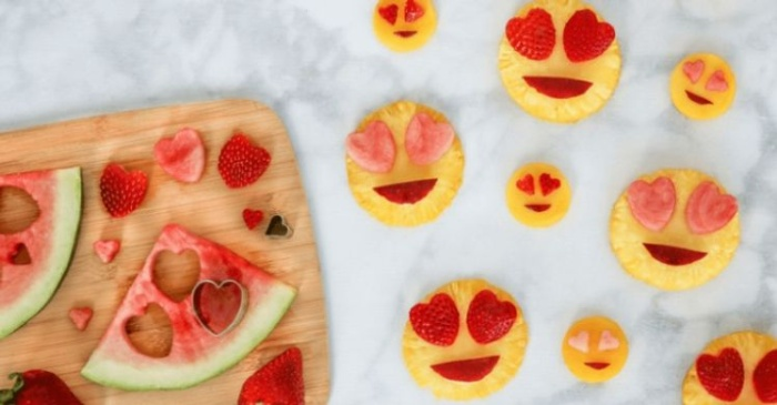 fun smiley faces made of pineapple with strawberries and watermelon