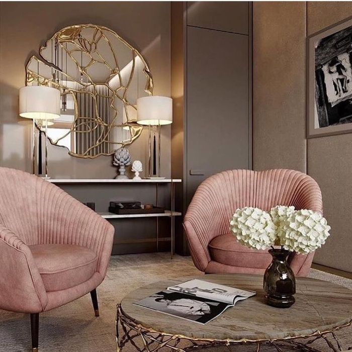 intuitive home decor luxurious room with pink chairs and golden accents
