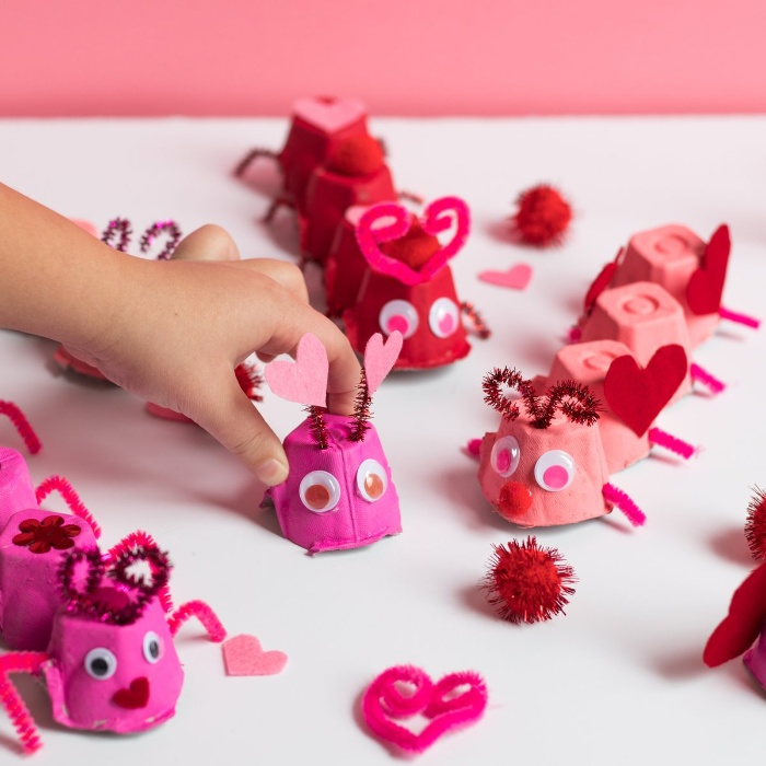 love bugs made of pink paper and hearts