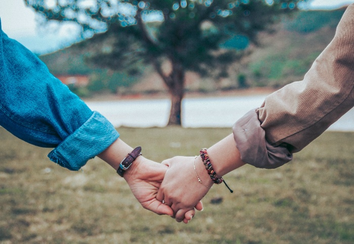 dating during pandemic couple outdoors holding hands