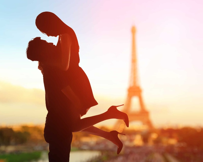 paris love story silhouettes of a couple in front of the Eiffel tower man holding a woman