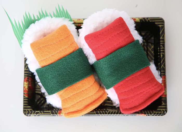 two sushi slippers on a tray red and yellow color