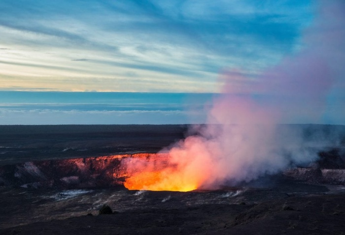National park of Hawaii volcano errupting hot red lava flames and smoke