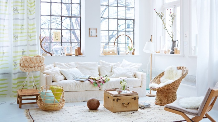 casual living room romantic retro decor in white with natural elements and large windows