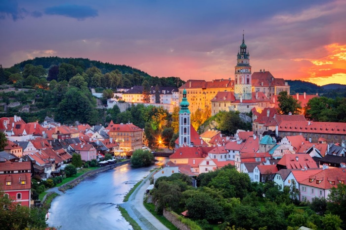 cesky krumlov small town in the evening river and clock towers