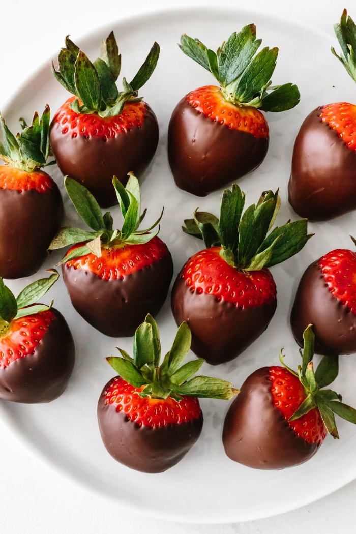 love and romance strawberries dipped in chocolate on a white plate