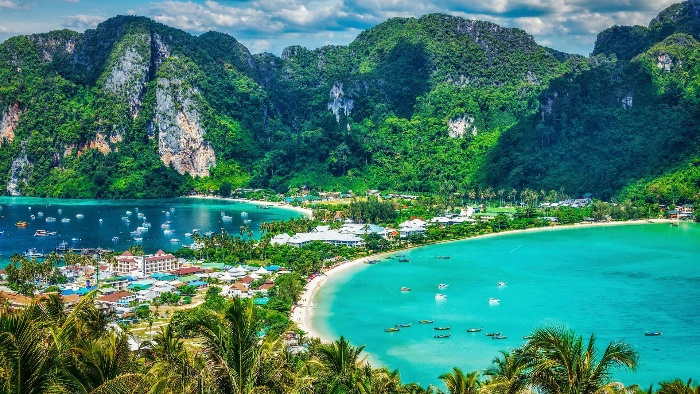 ko phi phi island and small town tropical green white beaches and mountains