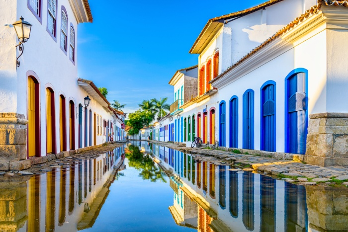 Paraty brazil small town with white houses and colorful doors water cannal