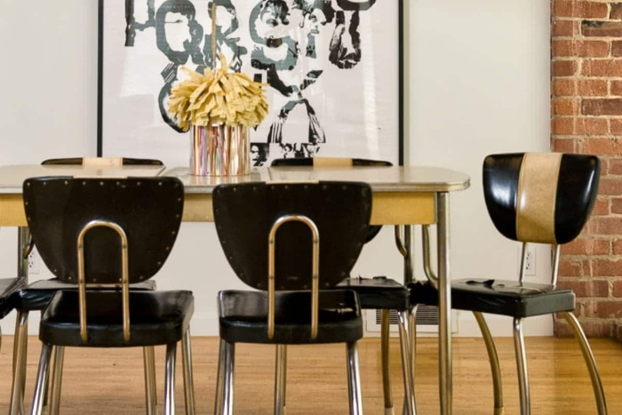 retro dining room with vintage black chairs and golden elements