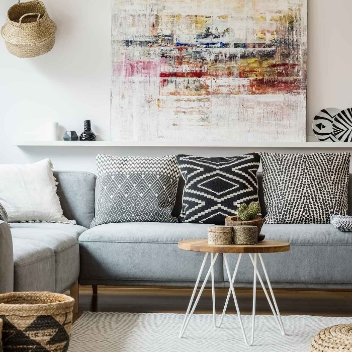 rustic living room interior grey sofa small table and big artwork
