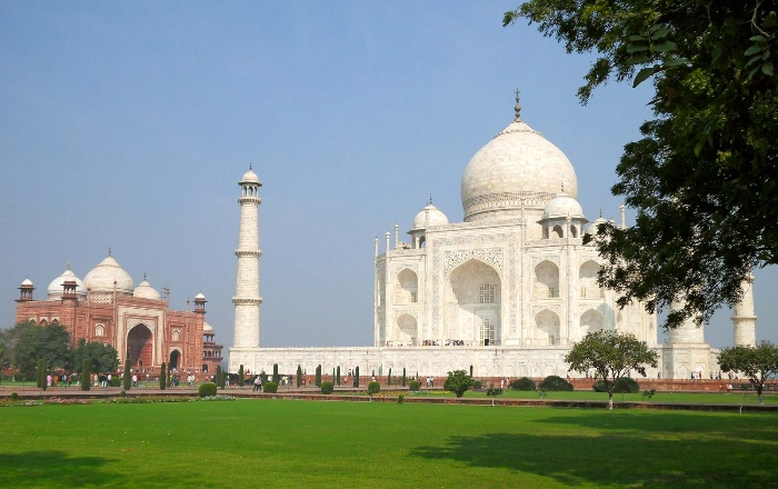 virtually visiting the taj mahal captured from afar with green grass in front