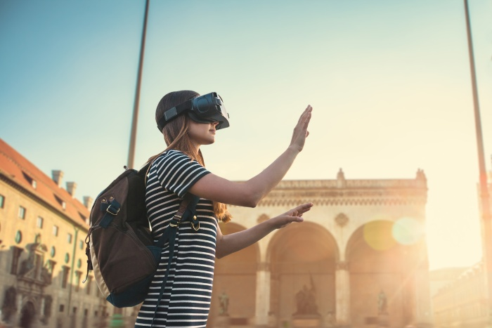 virtual travel girl with a backpack and vr glasses exploring a city