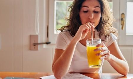 woman drinking a juice
