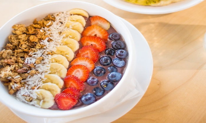 vegetarian easter breakfast acai bowl with different fruits and nuts