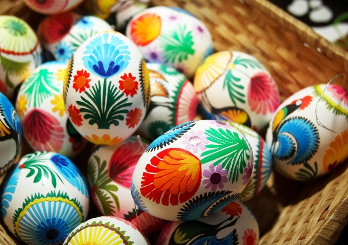 blown out eggs decorated with different colors and motifs
