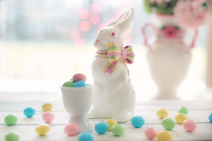 porcelain easter bunny with colorful candy around