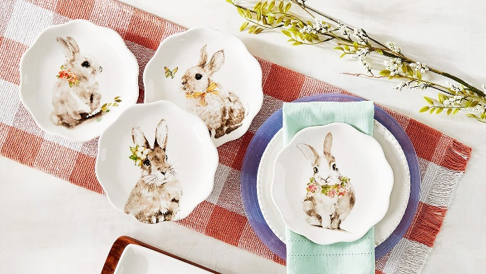 cute easter table decor with a table runner and plates with rabbits