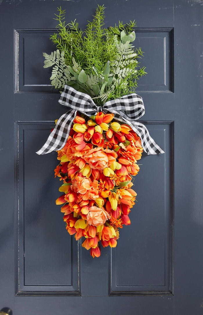 easter door decor carrot shaped wreath with a ribbon