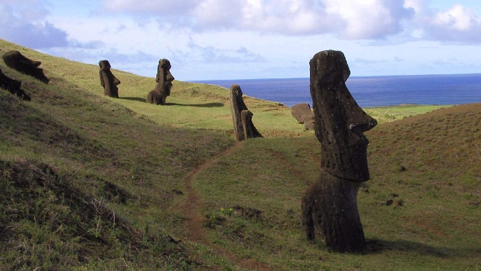 easter islands figures stone statues scattered around the hills of the island