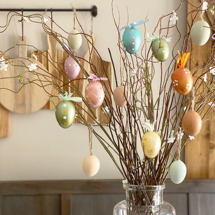 easter tree with colorful hollow eggs in a kitchen in a large vase