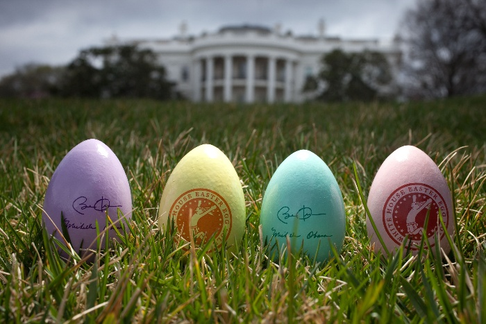 colored eggs with stamps on the lawn in front of the white house