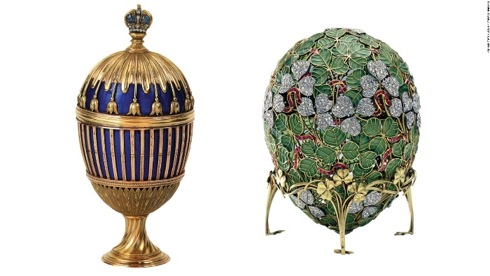 two gorgeous faberge eggs with precious stones and gold
