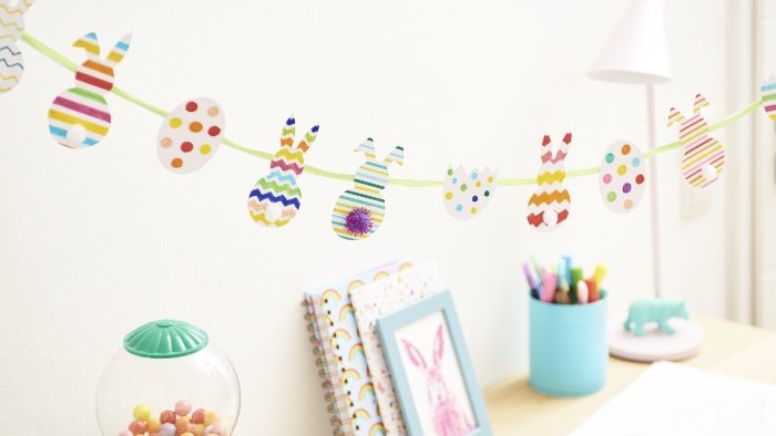 fun and colorful easter garland with bunny cut outs and eggs
