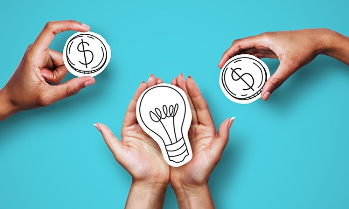 smart money people holding paper dollar signs and paper lightbulb in their hands