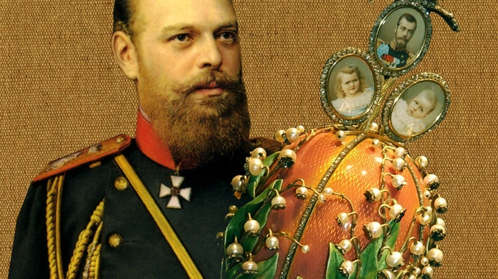The russian tsar and a faberge egg with the photos of children and lilly of the valley decorations