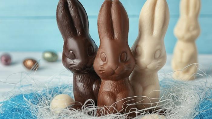 three bunnies from different chocolate white milk and dark