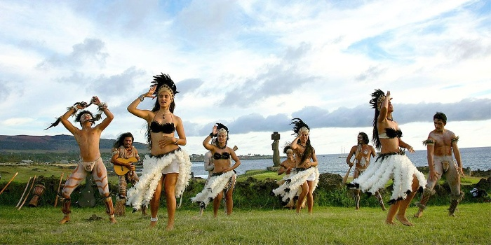 easter islands traditional dancing girls and boys in island costumes dancing outside