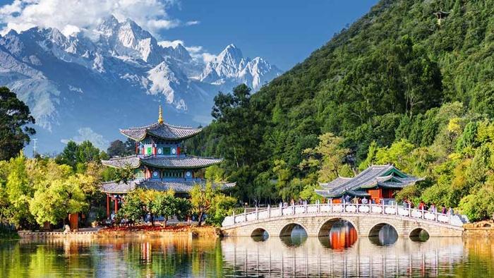 picture yunnan china mountains temple bridge and greenery lake