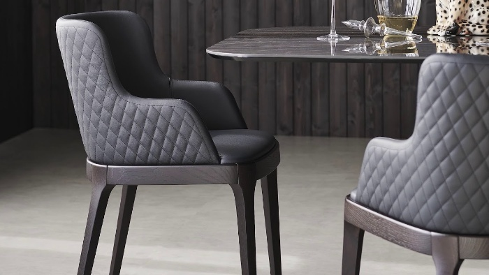 designer chair in metal gray glass table in a modern dining room