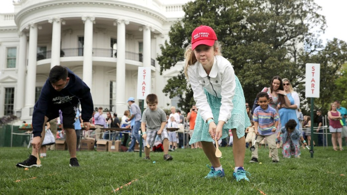 ester egg roll in front of the white house children pushing eggs on the lawn
