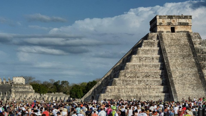 mexico people gathered in front of a pyramid welcoming spring celebration