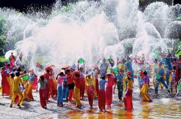 water festival thailand people in colorful clothes splashing water